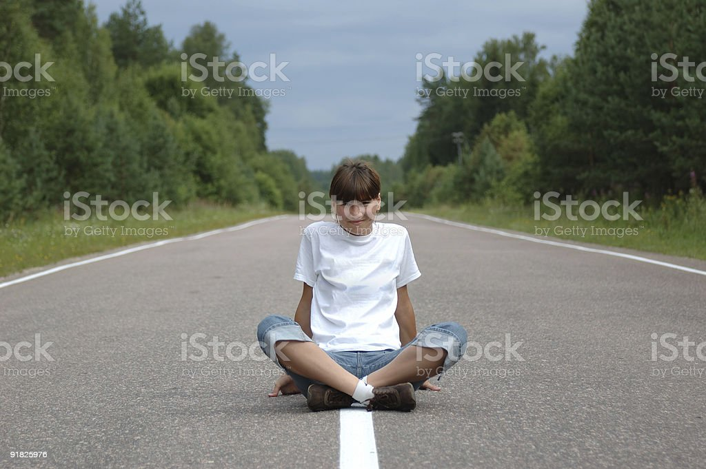 Girl sitting on road royalty-free stock photo