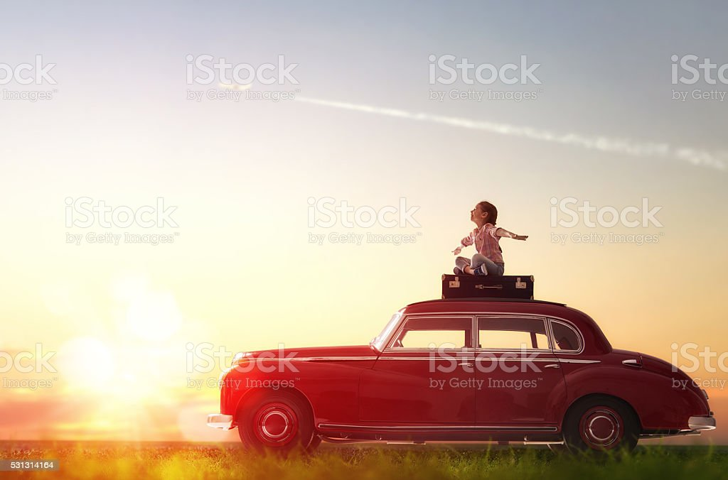 girl sitting on roof of car. stock photo