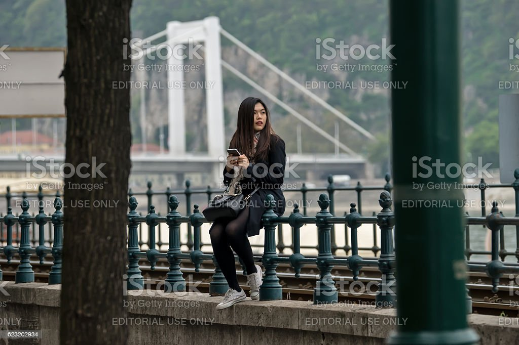 Girl sitting on the fence stock photo