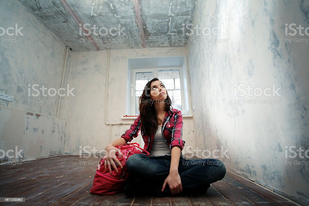 girl sitting on the floor crossing repairs stock photo