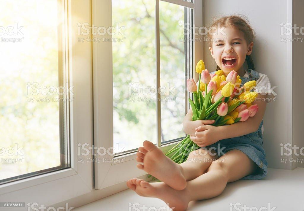 girl sitting on the window stock photo