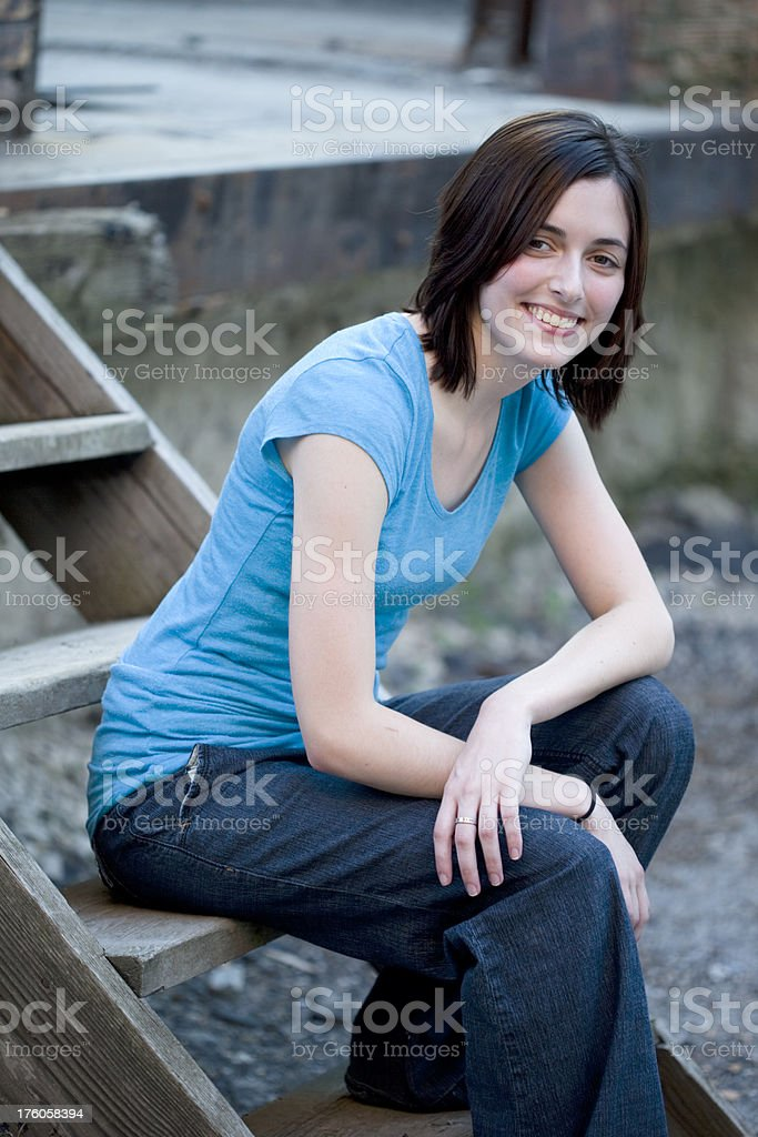 Girl Sitting on Wooden Steps royalty-free stock photo