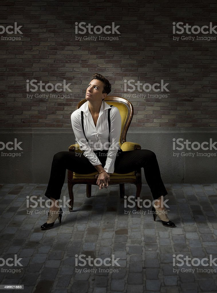 girl sitting with el born of barcelona behind stock photo
