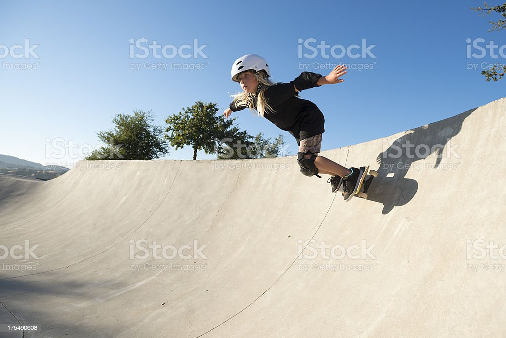 Girl Skateboarding stock photo