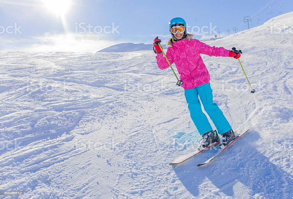 Girl skier in winter resort stock photo