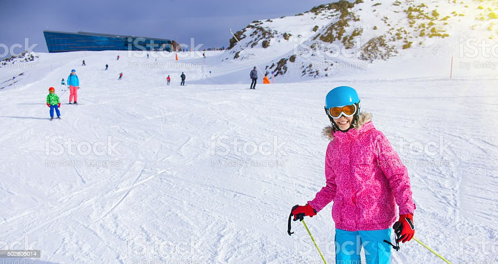 Girl skier in winter resort stock photo