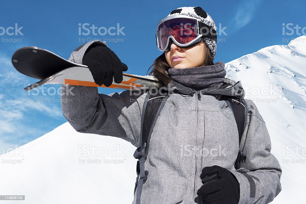 Girl skier on the top of a snowy  mountain stock photo