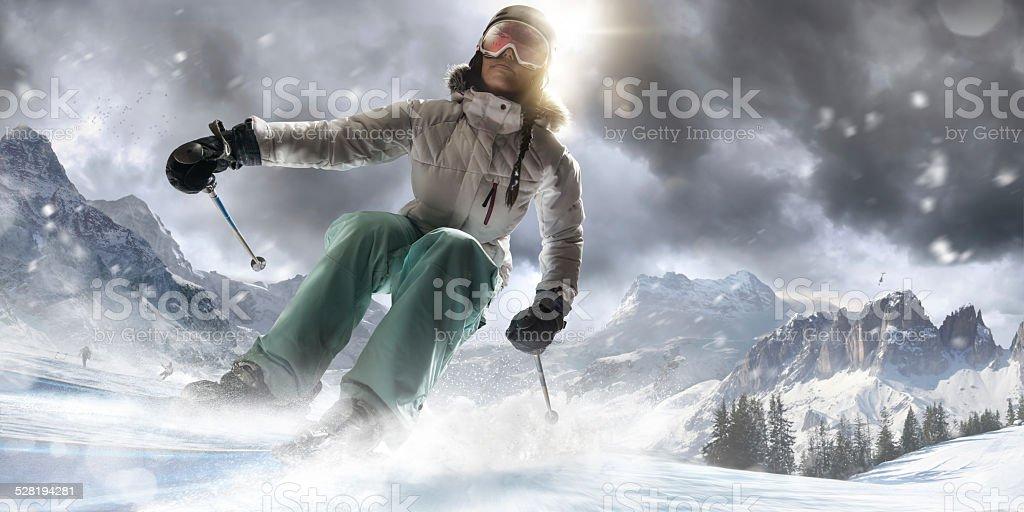 Girl Skiing Fast in Ski Resort stock photo