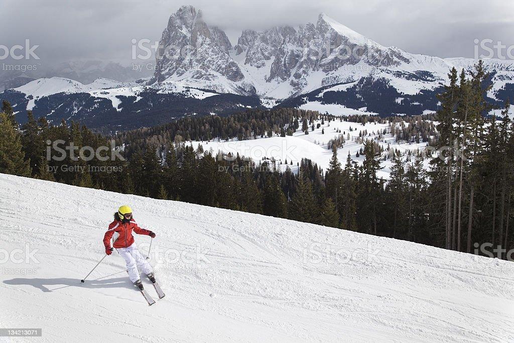 Girl skiing in Dolomites Mountains, Alto Adige, Italy (XXXL) royalty-free stock photo
