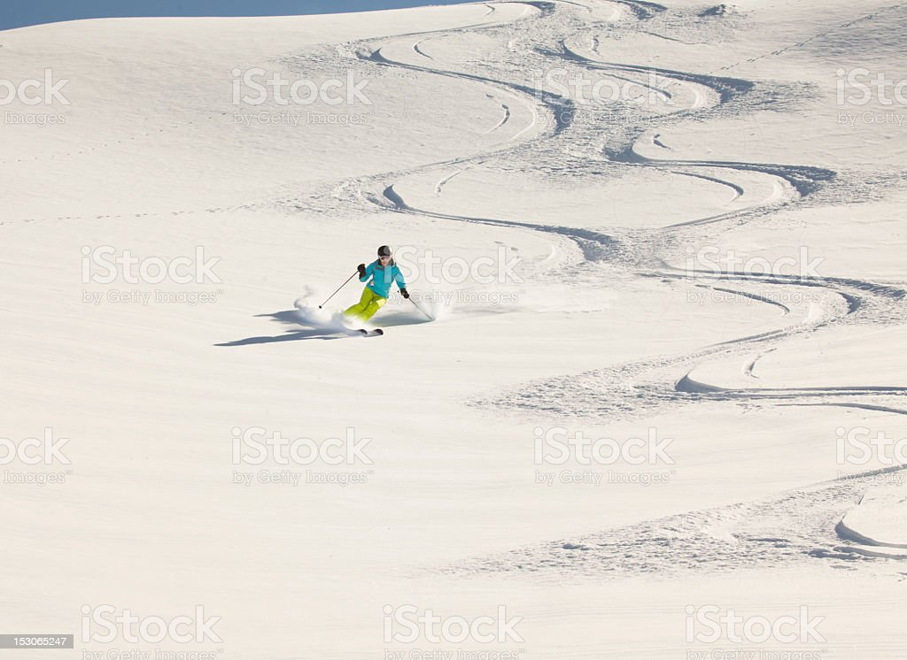 Girl skiing powder snow, New Zealand. stock photo