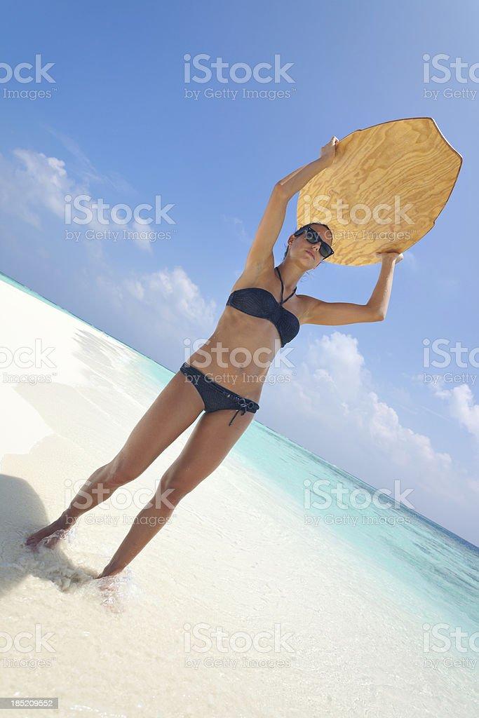 girl skimboard beach stock photo