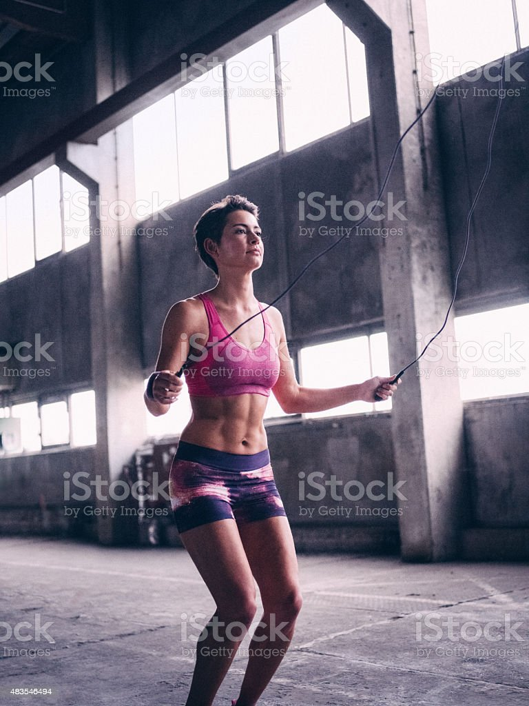 Girl skipping with a jump rope for exercise stock photo