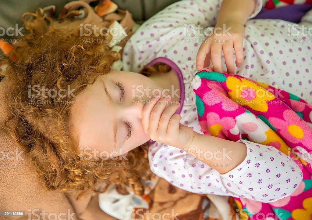 Girl Sleeping While Sucking Her Thumb stock photo