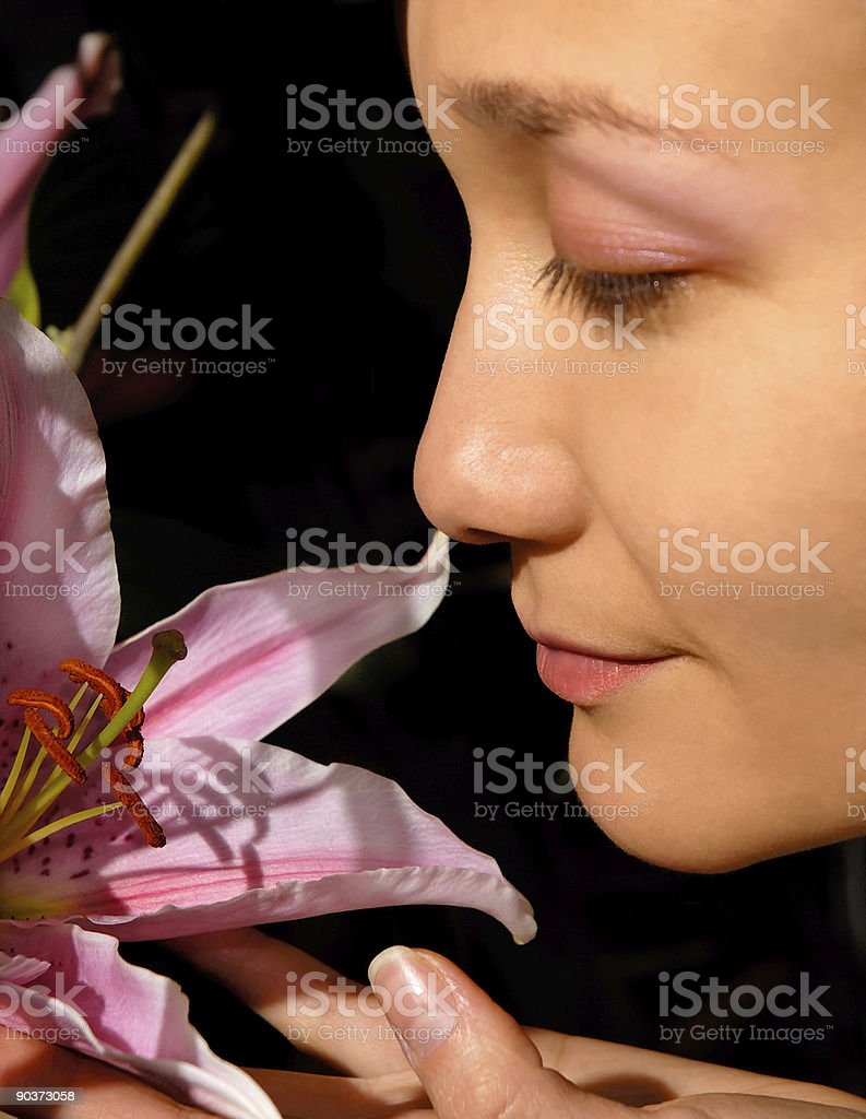 Girl smell pink lily flower royalty-free stock photo