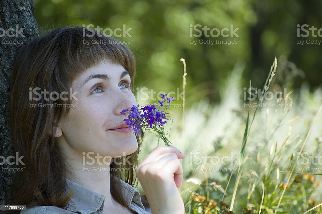 Girl smells a flowers royalty-free stock photo