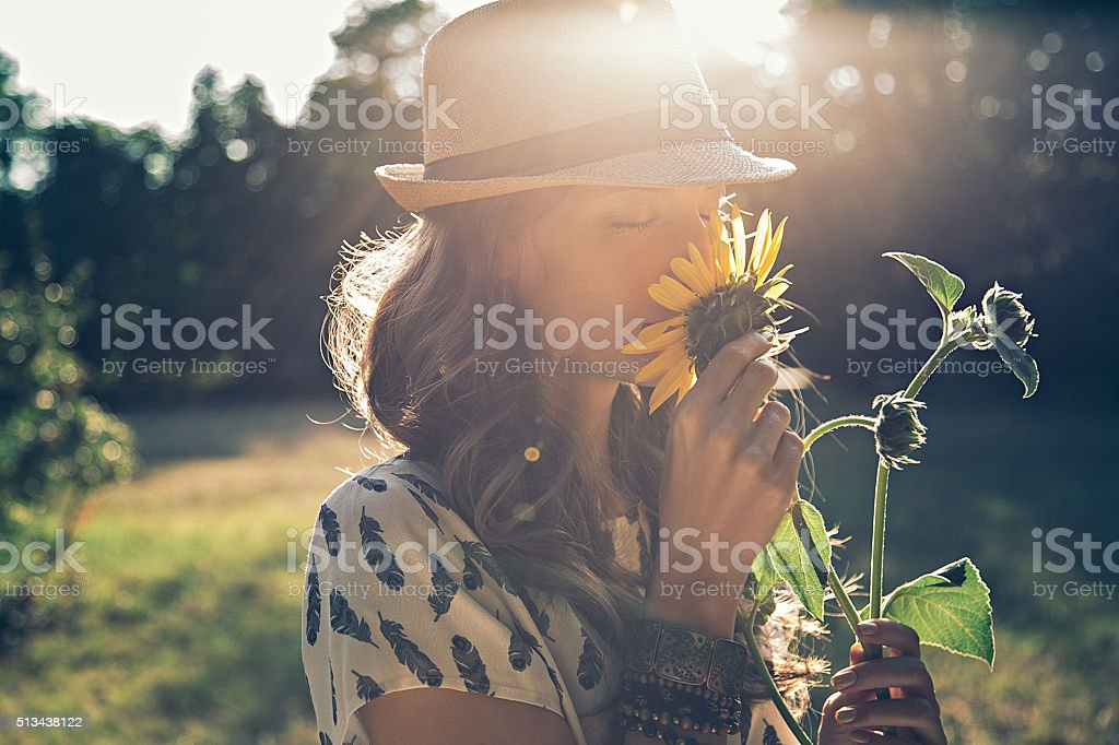 Girl smells sunflower stock photo