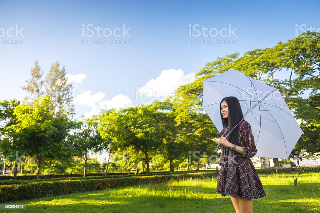 girl smile hold white umbrella stock photo