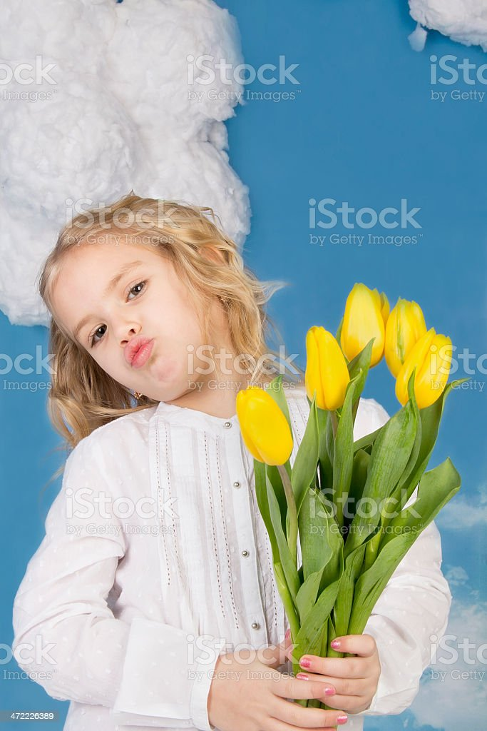 girl smiling and holding a bouquet of tulips stock photo