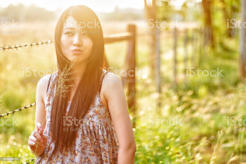 girl smiling in a meadow - happy girl stock photo