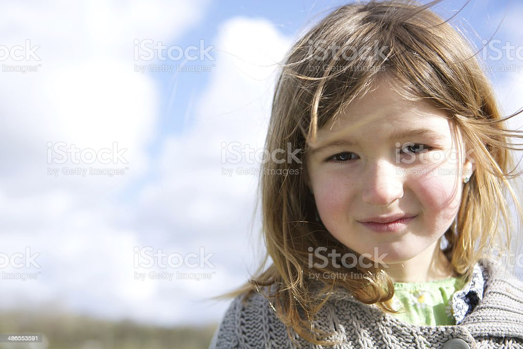Girl smiling outdoors stock photo