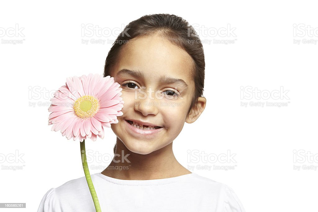 Girl smiling with pink flower royalty-free stock photo