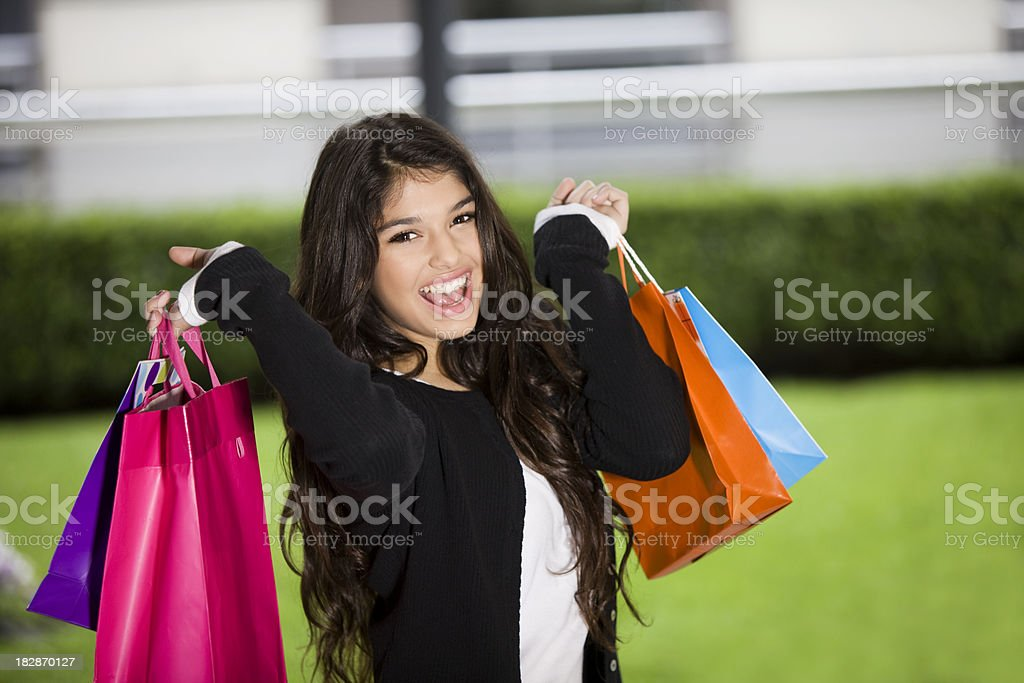 Girl Smiling with Shopping Bags royalty-free stock photo