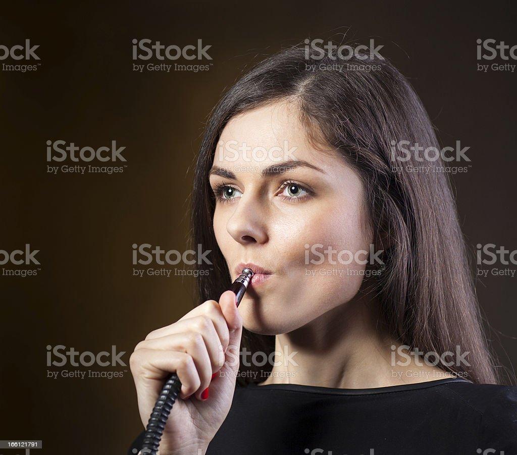 girl smokes a hookah royalty-free stock photo