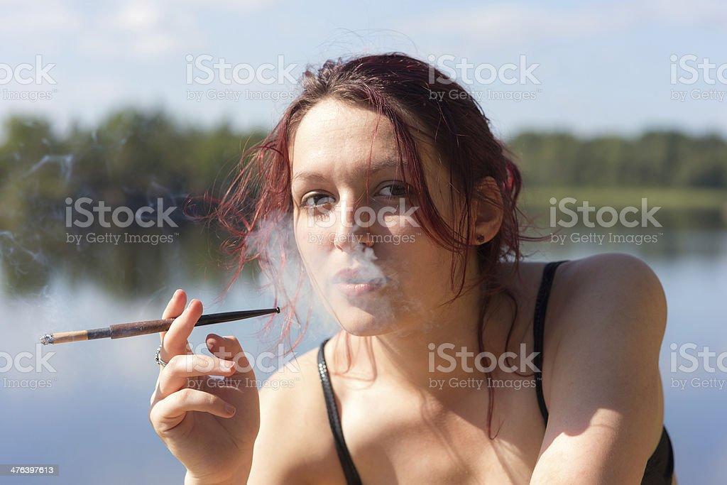 girl smoking on the lake royalty-free stock photo