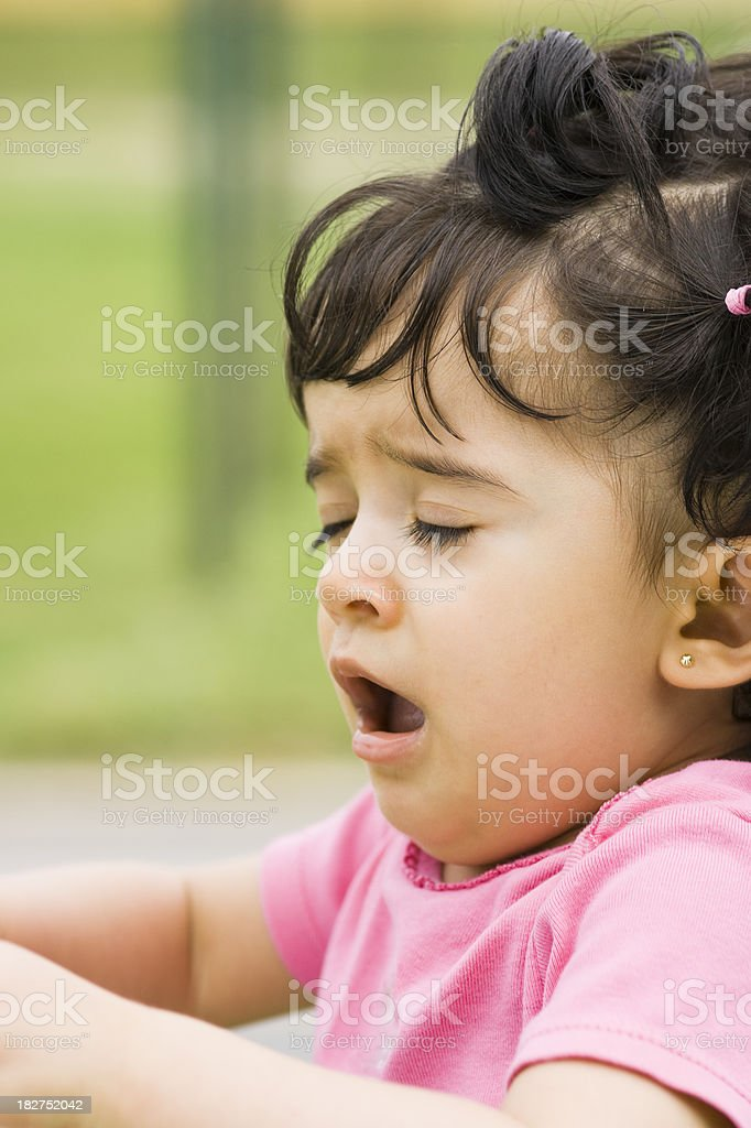 Girl Sneezing at the Park royalty-free stock photo