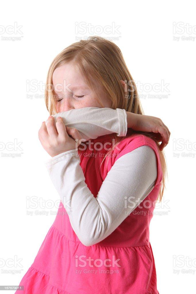 girl sneezing into arm royalty-free stock photo