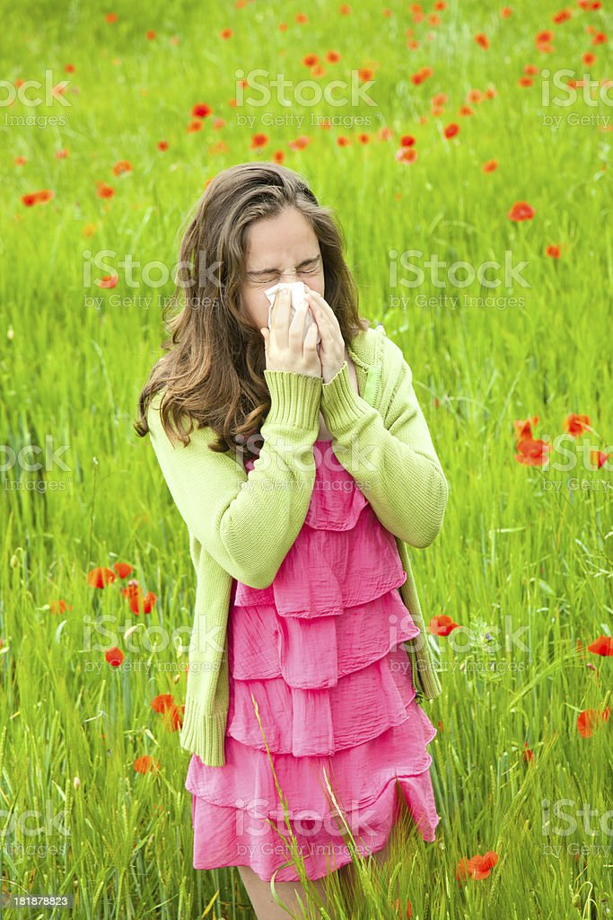 Girl sneezing royalty-free stock photo