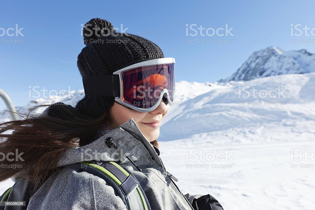 Girl snow skier on overhead cable car stock photo