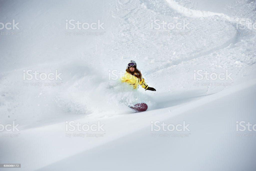 Girl snowboarder off-piste backcountry freeriding stock photo