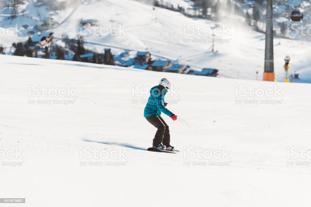 Girl snowboarding in the Alps stock photo