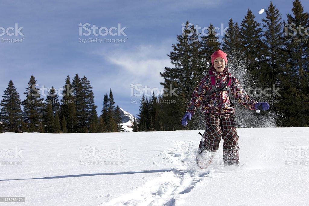 Girl snowshoeing royalty-free stock photo