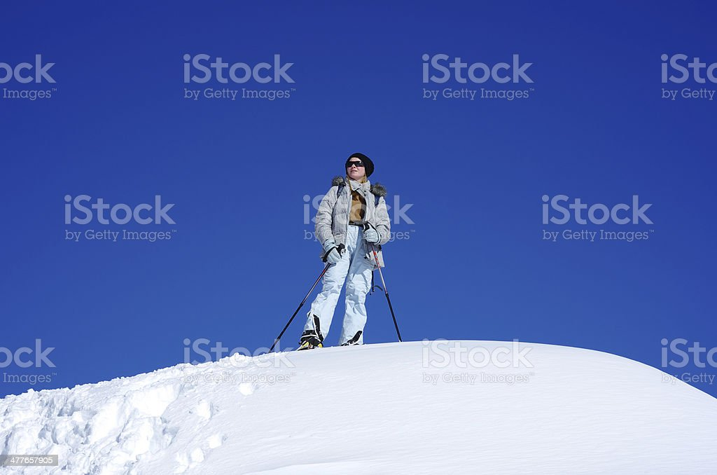 Girl snowshoeing trip on top, blue sky royalty-free stock photo