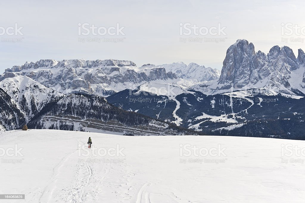 Girl snowshoes in the wide Dolomites Panorama stock photo