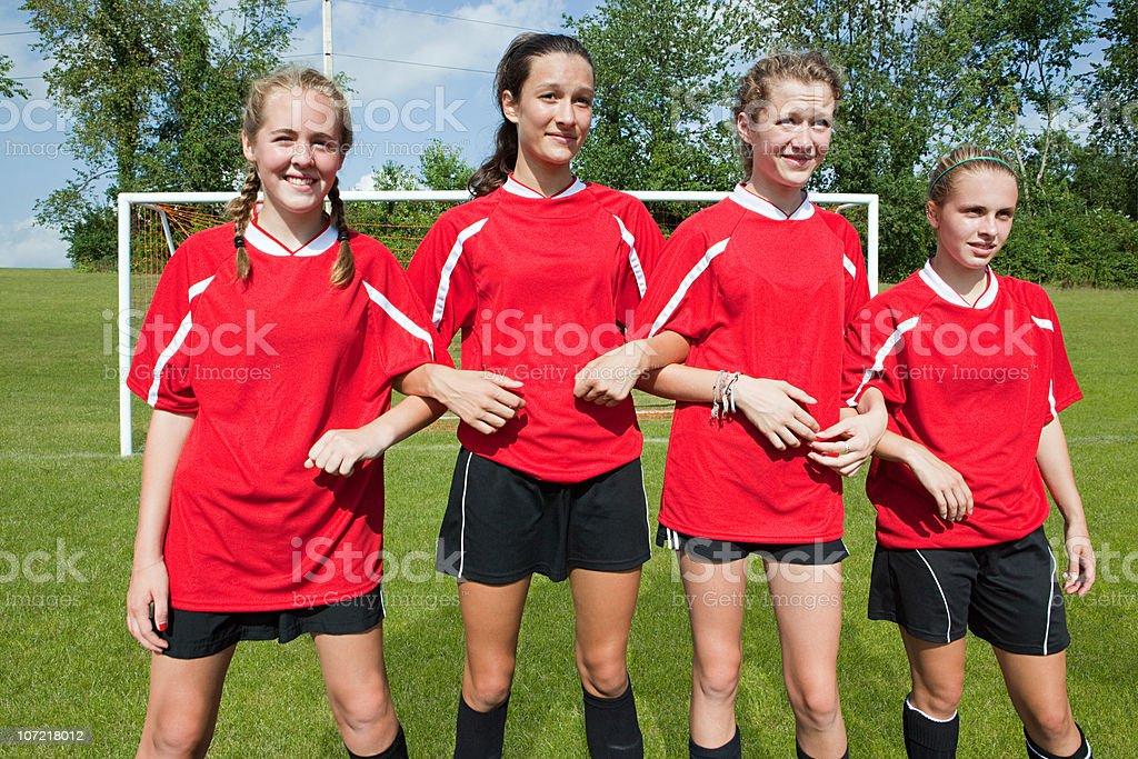 Girl soccer players make defensive wall stock photo