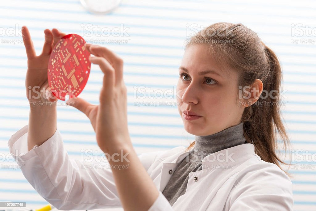 Girl Solder and adjust Electronic Device stock photo