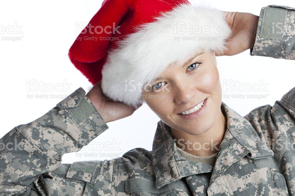 girl soldier wearing christmas santa hat royalty-free stock photo