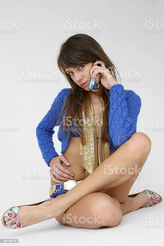 Girl speaks by a mobile phone. royalty-free stock photo