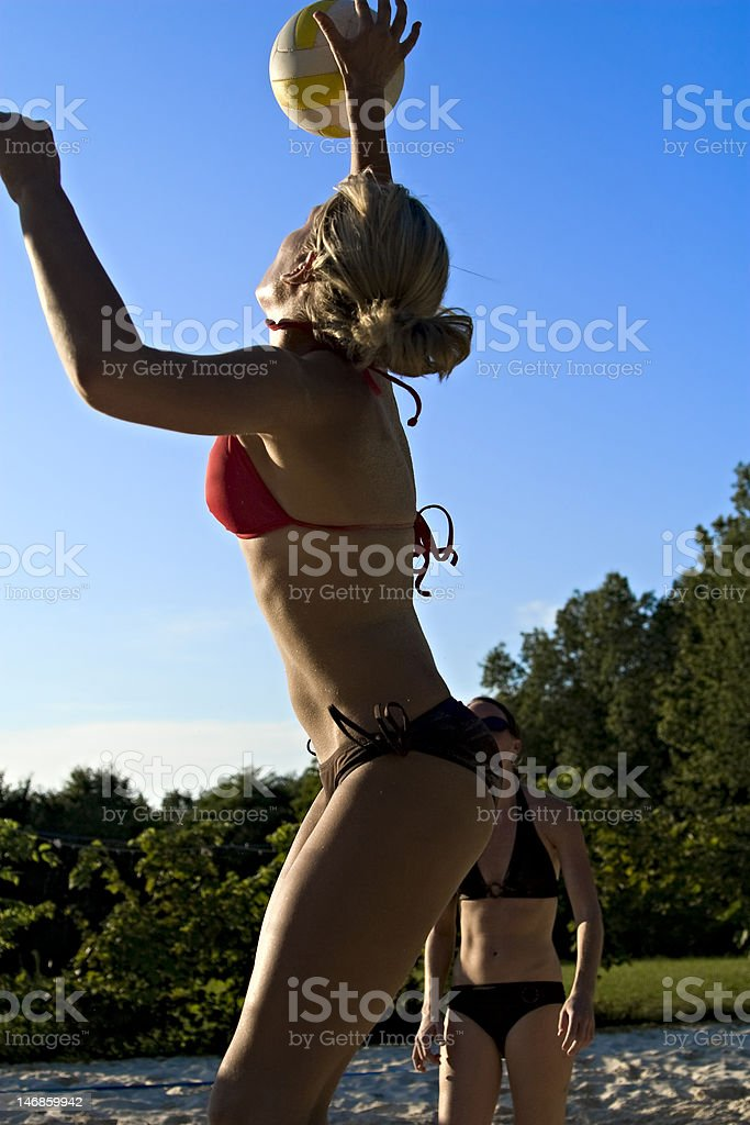 Girl spiking a volleyball. royalty-free stock photo