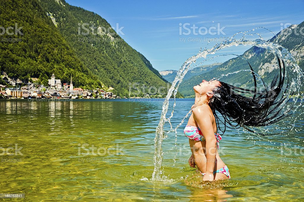 Girl splashing in the lake royalty-free stock photo