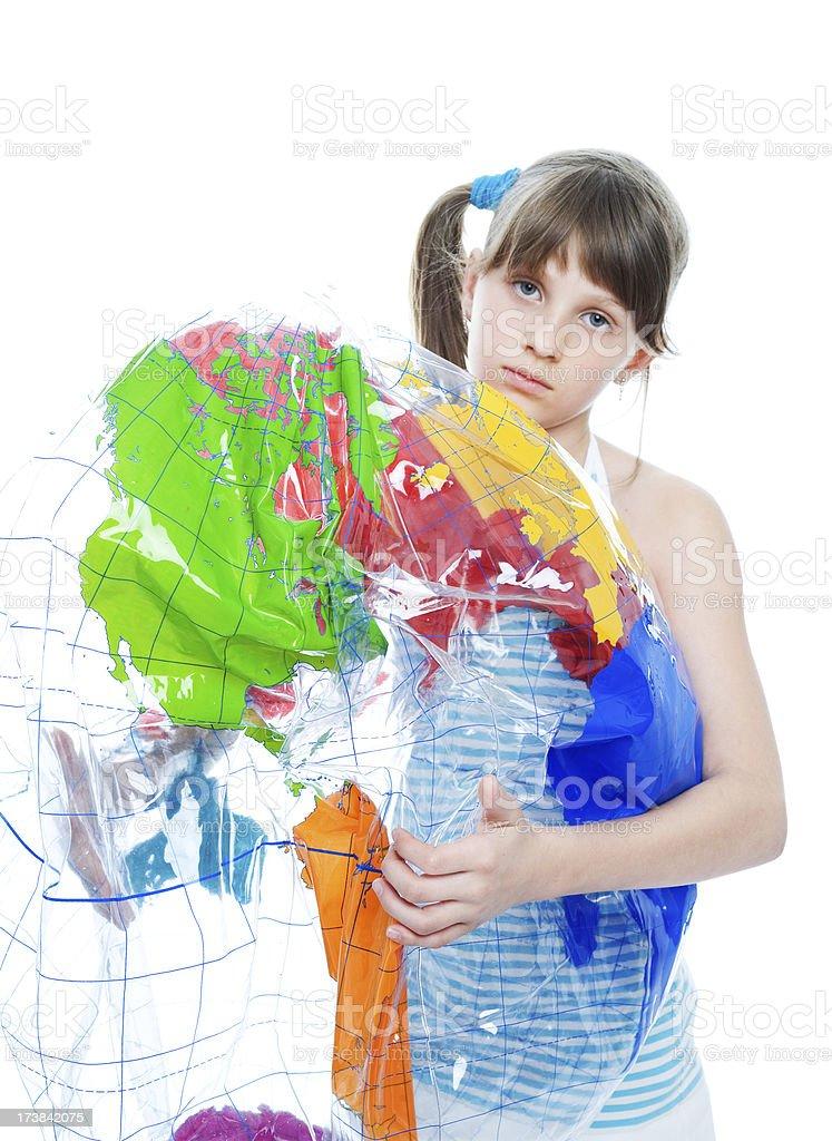 Girl Squashing Inflatable Globe stock photo