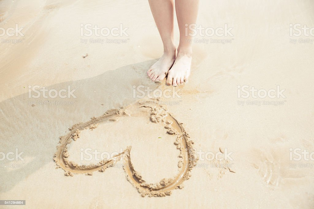 girl stand beside the ocean stock photo
