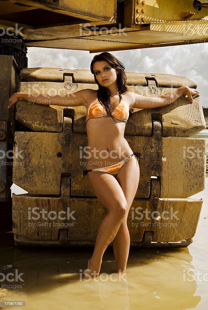 girl standing in front of machine royalty-free stock photo