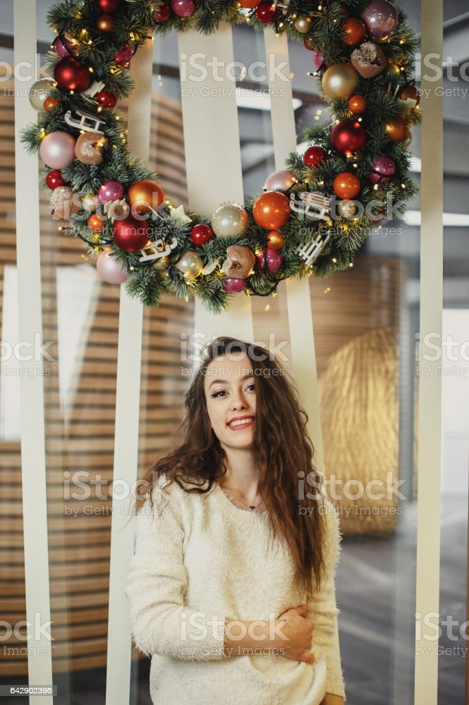Girl standing in holiday background and looking at camera stock photo