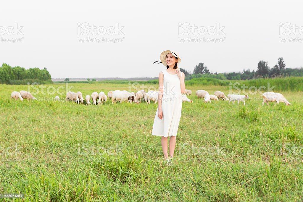 girl standing in pasture stock photo