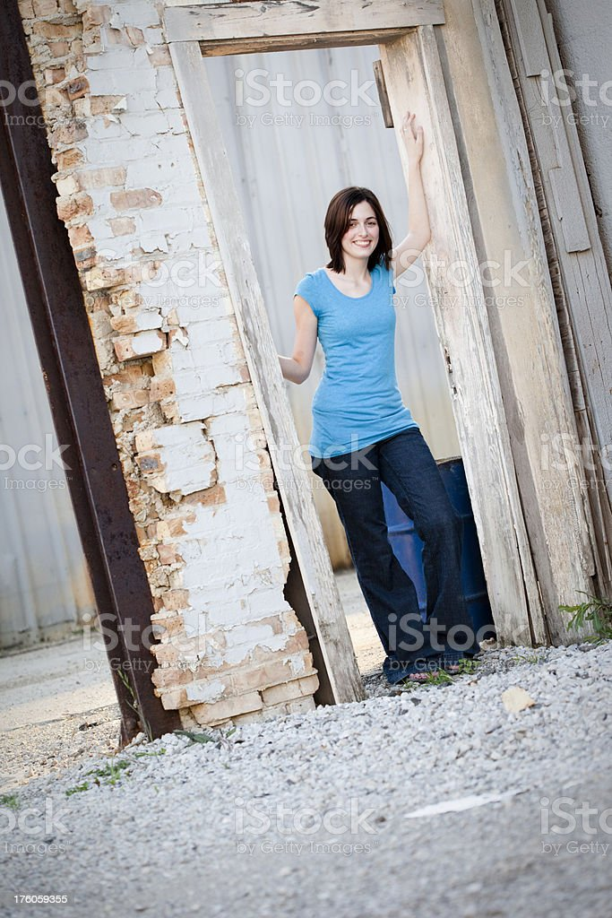 Girl Standing in Run Down Urban Area royalty-free stock photo