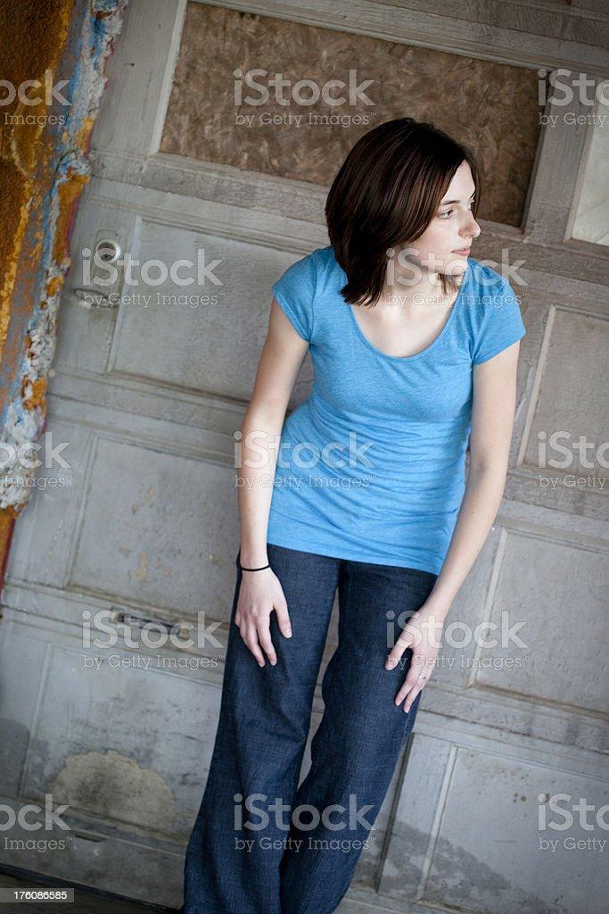 Girl Standing in Run Down Urban Area royalty-free stock photo